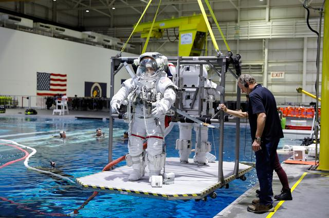 NASA Commercial Crew astronauts  Sunita Williams and Josh Cassada are seen lowered into the water at NASA's Neutral Buoyancy Laboratory (NBL) training facility near the Johnson Space Center in Houston, Texas, U.S., July 1, 2019.     REUTERS/Mike Blake