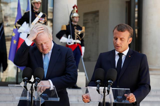 British Prime Minister Boris Johnson and French President Emmanuel Macron deliver a joint statement before a meeting on Brexit at the Elysee Palace in Paris, France, August 22, 2019. REUTERS/Gonzalo Fuentes