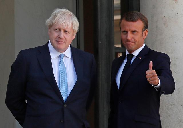 French President Emmanuel Macron reacts next to British Prime Minister Boris Johnson after a joint statement before a meeting on Brexit at the Elysee Palace in Paris, France, August 22, 2019. REUTERS/Gonzalo Fuentes