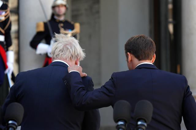 French President Emmanuel Macron and British Prime Minister Boris Johnson leave after a joint statement before a meeting on Brexit at the Elysee Palace in Paris, France, August 22, 2019. REUTERS/Gonzalo Fuentes