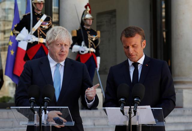 French President Emmanuel Macron and British Prime Minister Boris Johnson deliver a joint statement before a meeting on Brexit at the Elysee Palace in Paris, France, August 22, 2019. REUTERS/Gonzalo Fuentes