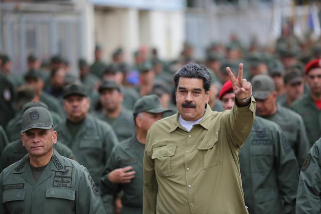 FILE PHOTO: Venezuela's President Nicolas Maduro gestures during a meeting with soldiers at a military base in Caracas, Venezuela January 30, 2019. Miraflores Palace/Handout via REUTERS/File Photo