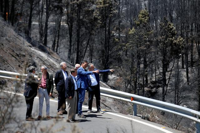 Spain's acting Prime Minister Pedro Sanchez visits Gran Canaria in Canary Islands that has been affected by Spain's worst wildfire in six years, in Valleseco, Spain, August 22, 2019. REUTERS/Borja Suarez