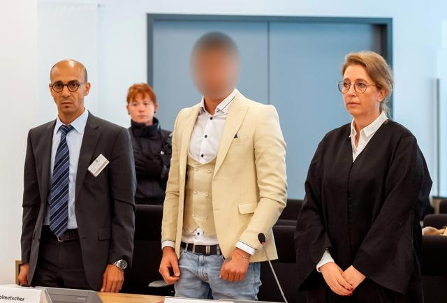 Alaa S., suspected of being responsible for the stabbing of Daniel H. in Chemnitz, his interpreter and lawyer Ricarda Lang arrive at a court in Dresden, Germany, August 22, 2019. Picture pixelated at source.      Matthias Rietschel/Pool via REUTERS