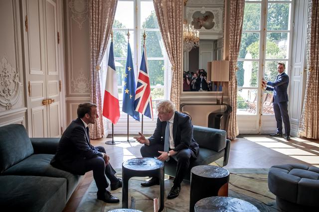 French President Emmanuel Macron and British Prime Minister Boris Johnson speak during a meeting at the Elysee Palace in Paris, France, August 22, 2019. Christophe Petit Tesson/Pool via REUTERS