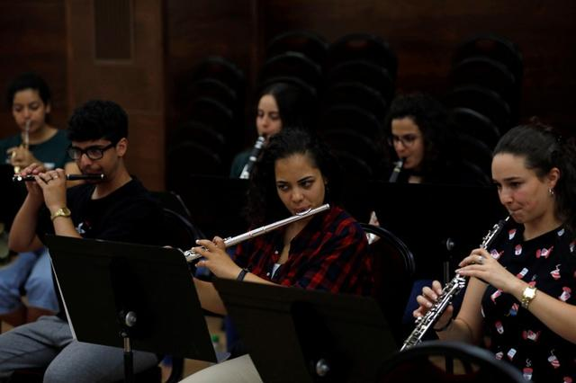 Members of the Palestine Youth Orchestra's wind section rehearse at the Edward Said National Conservatory of Music's Ramallah branch, in the Israeli-occupied West Bank July 24, 2019.  REUTERS/Mohamad Torokman