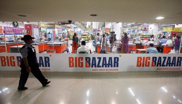 FILE PHOTO: A security personnel walks past the Big Bazaar retail store in Mumbai June 9, 2012.  REUTERS/Vivek Prakash/File Photo