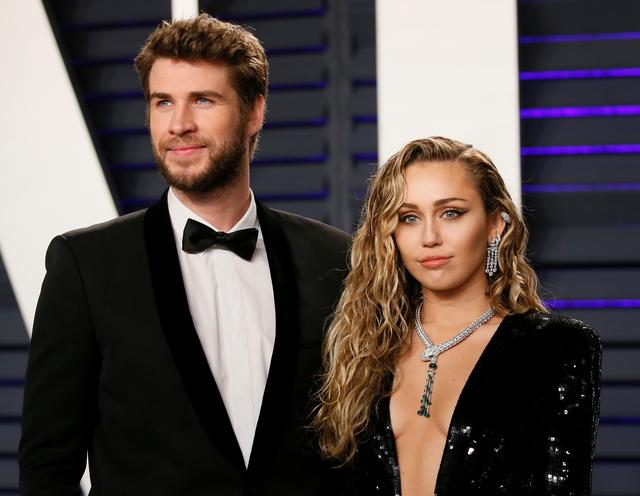 FILE PHOTO: 91st Academy Awards – Vanity Fair – Beverly Hills, California, U.S., February 24, 2019 – Liam Hemsworth and Miley Cyrus. REUTERS/Danny Moloshok/File Photo