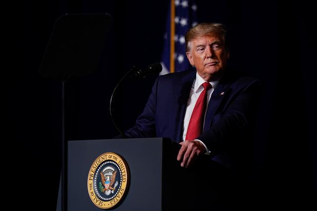 U.S. President Donald Trump speaks at the AMVETS (American Veterans) National Convention in Louisville, Kentucky. U.S., August 21, 2019.   REUTERS/Bryan Woolston
