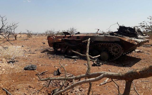 A damaged military tank is seen in Idlib countryside, Syria in this handout released by SANA on August 22, 2019. SANA/Handout via REUTERS