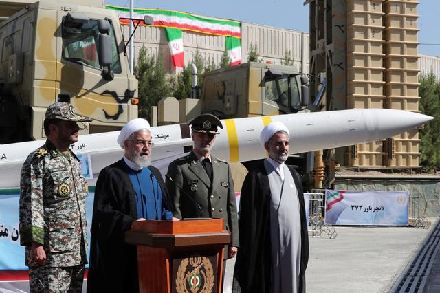 FILE PHOTO: Iranian President Hassan Rouhani delivers a speech during the unveiling ceremony for the domestically built mobile missile defence system Bavar-373, to mark the National Defence Industry Day in Tehran, Iran August 22, 2019. Official President website/Handout via REUTERS