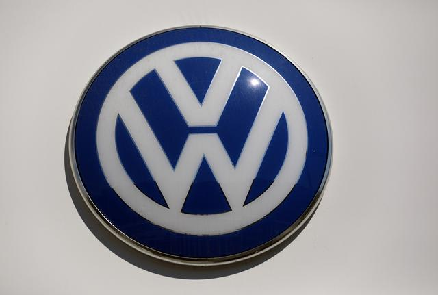 FILE PHOTO: The logo of Volkswagen carmaker is seen at the entrance of a showroom in Nice, France, April 8, 2019.  REUTERS/Eric Gaillard
