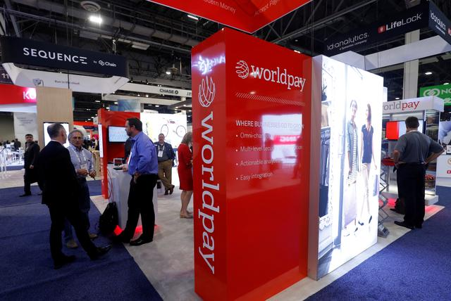 FILE PHOTO: A Worldpay booth is shown on the exhibit hall floor during the Money 20/20 conference in Las Vegas, Nevada, U.S. on October 24, 2017. REUTERS/Steve Marcus