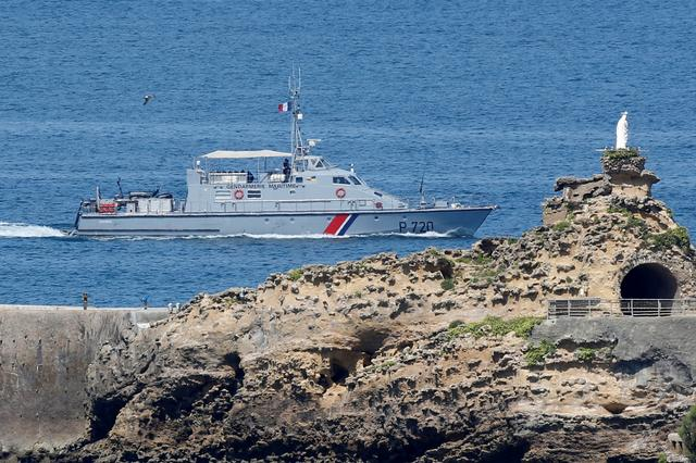 FILE PHOTO: French gendarmes on a boat patrol the coast next to the Virgin's Rock on the eve of the G7 summit in Biarritz, France, August 23, 2019.  REUTERS/Regis Duvignau/File Photo