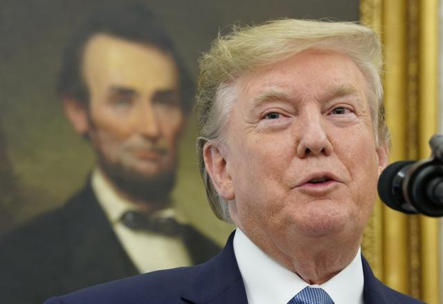 FILE PHOTO: U.S. President Donald Trump speaks in front of a portrait of former U.S. President Abraham Lincoln prior to presenting the Presidential Medal of Freedom to Boston Celtics legend and Basketball Hall of Famer Bob Cousy at the White House in Washington, U.S., August 22, 2019. REUTERS/Kevin Lamarque