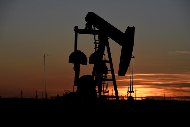FILE PHOTO: A pump jack operates at sunset in an oil field in Midland, Texas U.S. August 22, 2018. REUTERS/Nick Oxford