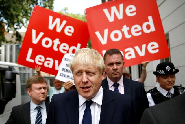 FILE PHOTO: Boris Johnson leaves his office in London, Britain July 22, 2019. REUTERS/Henry Nicholls/File Photo