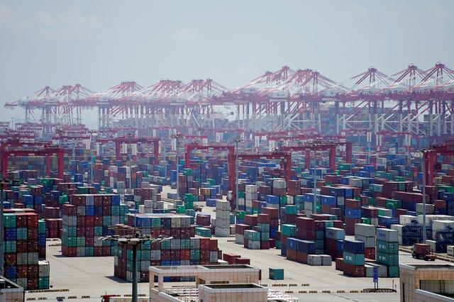 FILE PHOTO: Containers are seen at the Yangshan Deep Water Port in Shanghai, China August 6, 2019. REUTERS/Aly Song