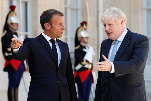 FILE PHOTO: French President Emmanuel Macron welcomes British Prime Minister Boris Johnson before a meeting on Brexit at the Elysee Palace in Paris, France, August 22, 2019. REUTERS/Gonzalo Fuentes