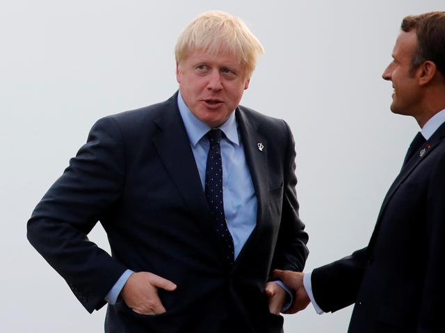 French President Emmanuel Macron welcomes Britain's Prime Minister Boris Johnson as he arrives for a banquet during the G7 summit in Biarritz, France, August 24, 2019. REUTERS/Carlos Barria
