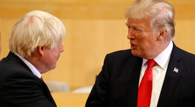 U.S. President Donald Trump greets British Foreign Secretary Boris Johnson (L) as they take part in a session on reforming the United Nations at U.N. Headquarters in New York, U.S., September 18, 2017. REUTERS/Kevin Lamarque