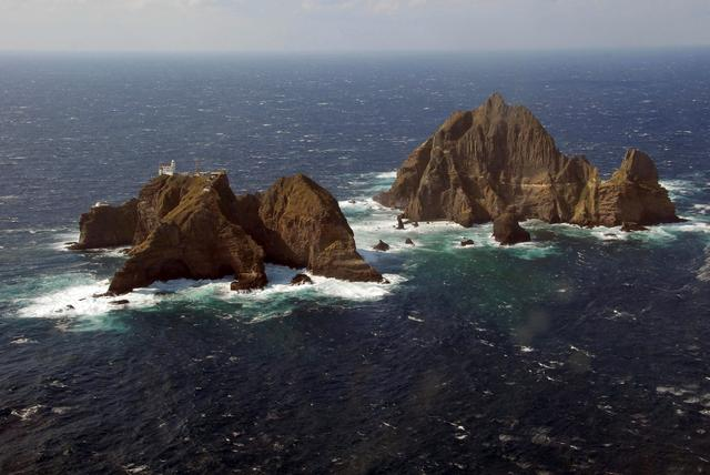 FILE PHOTO: An aerial view shows a part of the group of islets known in South Korea as Dokdo and in Japan as Takeshima in the Sea of Japan, October 20, 2007.  REUTERS/Yuri Maltsev/File Photo