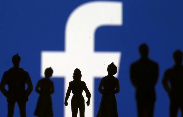 FILE PHOTO: Small toy figures are seen in front of Facebook logo in this illustration picture, April 8, 2019. REUTERS/Dado Ruvic/Illustration/File Photo