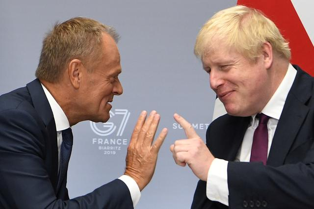 Britain's Prime Minister Boris Johnson meets European Union Council President Donald Tusk at a bilateral meeting during the G7 summit in Biarritz, France August 25, 2019.  Andrew Parsons/Pool via REUTERS