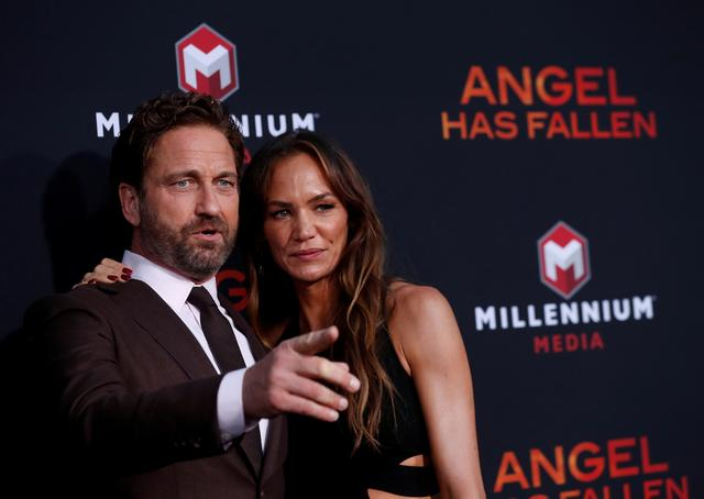 "FILE PHOTO: Gerard Butler and Morgan Brown attend the premiere for the film ""Angel Has Fallen"" in Los Angeles, California, U.S., August 20, 2019. REUTERS/Mario Anzuoni/File Photo"