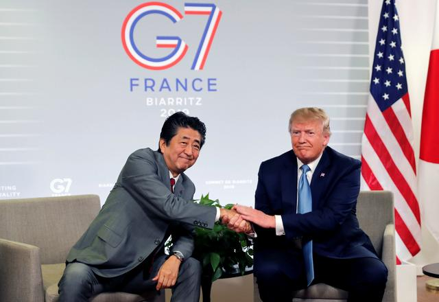 U.S. President Donald Trump and Japan's Prime Minister Shinzo Abe shake hands as they attend a bilateral meeting during the G7 summit in Biarritz, France, August 25, 2019. REUTERS/Carlos Barria