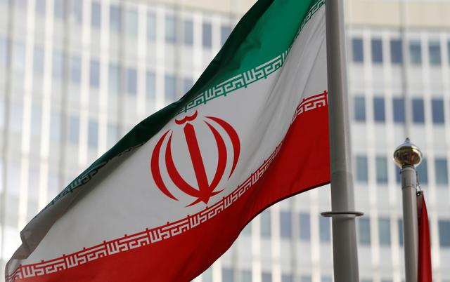 FILE PHOTO: The Iranian flag flutters in front the International Atomic Energy Agency (IAEA) headquarters in Vienna, Austria March 4, 2019.   REUTERS/Leonhard Foeger
