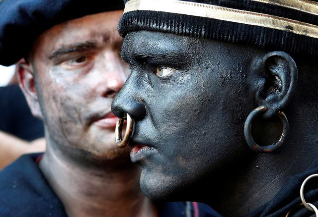 """The Savage"", a white performer in a blackface disguise, takes part in the festival Ducasse d'Ath, in the western town of Ath, Belgium August 25, 2019. REUTERS/Francois Lenoir"
