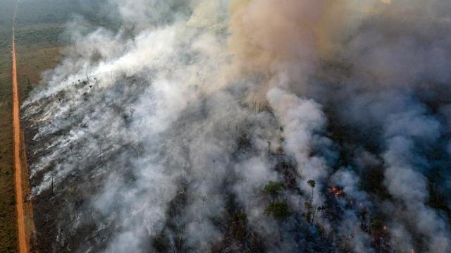 An aerial view of forest fire of the Amazon taken with a drone is seen from an Indigenous territory in the state of Mato Grosso, in Brazil, August 23, 2019, obtained by Reuters on August 25, 2019.  Marizilda Cruppe/Amnesty International/Handout via REUTERS
