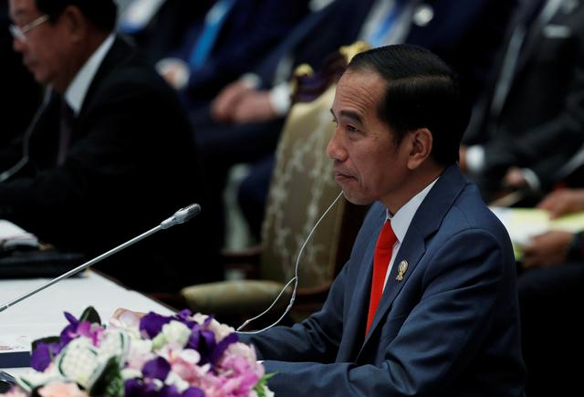 FILE PHOTO - Indonesia's Incumbent President Joko Widodo attends a plenary session during the 34th ASEAN Summit in Bangkok, Thailand, June 22, 2019. REUTERS/Jorge Silva