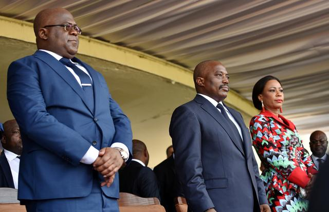 FILE PHOTO: Democratic Republic of Congo's outgoing President Joseph Kabila and his successor Felix Tshisekedi take part in the latter's inauguration ceremony in Kinshasa, Democratic Republic of Congo January 24, 2019. REUTERS/ Olivia Acland