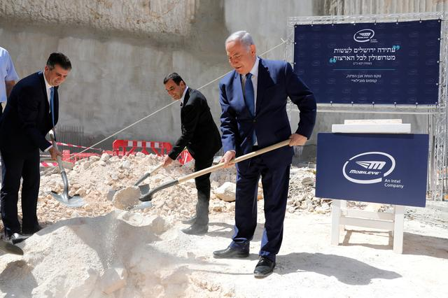 Israeli Prime Minister Benjamin Netanyahu, Mobileye founder Amnon Shashua (C) and Minister of Economy and Industry Eli Cohen (L) take part in a cornerstone-laying ceremony for Mobileye's center in Jerusalem August 27, 2019. Abir Sultan/Pool via REUTERS