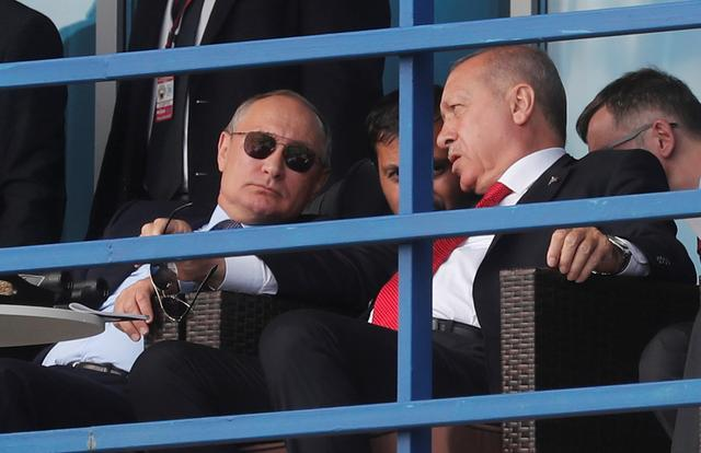 Russian President Vladimir Putin and Turkish President Recep Tayyip Erdogan watch demonstration flights during the opening of the MAKS-2019 International Aviation and Space Salon in Zhukovsky outside Moscow, Russia, August 27, 2019. Maxim Shipenkov/Pool via REUTERS
