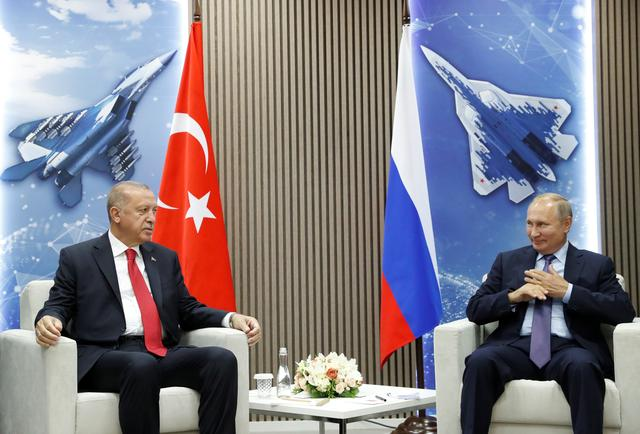 Russian President Vladimir Putin and Turkish President Recep Tayyip Erdogan speak during their meeting on the sidelines of the MAKS-2019 International Aviation and Space Salon in Zhukovsky outside Moscow, Russia, August  27, 2019. Maxim Shipenkov/Pool via REUTERS