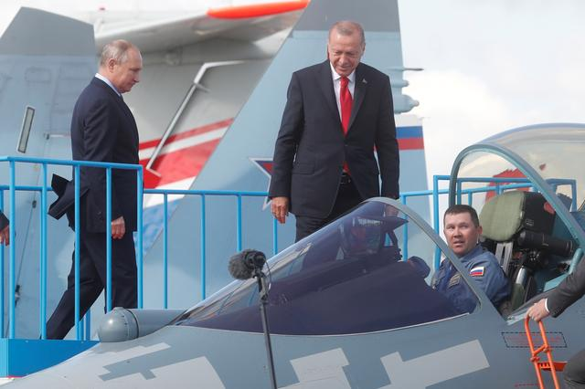 Russian President Vladimir Putin and Turkish President Recep Tayyip Erdogan inspect Sukhoi Su-57 fifth-generation fighter during the MAKS-2019 International Aviation and Space Salon in Zhukovsky outside Moscow, Russia, August  27, 2019. Maxim Shipenkov/Pool via REUTERS