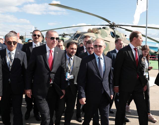 Russian President Vladimir Putin and his Turkish counterpart Tayyip Erdogan visit the MAKS-2019 International Aviation and Space Salon in Zhukovsky outside Moscow, Russia, August 27, 2019. Murat Cetinmuhurdar/Presidential Press Office/Handout via REUTERS