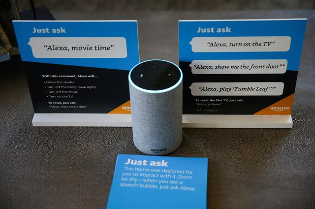 FILE PHOTO: Prompts on how to use Amazon's Alexa personal assistant are seen alongside an Amazon Echo in an Amazon 'experience center'  in Vallejo, California, U.S., May 8, 2018. REUTERS/Elijah Nouvelage/File Photo