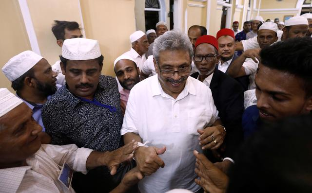 Sri Lanka's former wartime defense secretary and presidential candidate Gotabaya Rajapaksa shares a moment with Muslims during his visit at Ketchimale mosque in Beruwala, Sri Lanka August 17, 2019. REUTERS/Dinuka Liyanawatte