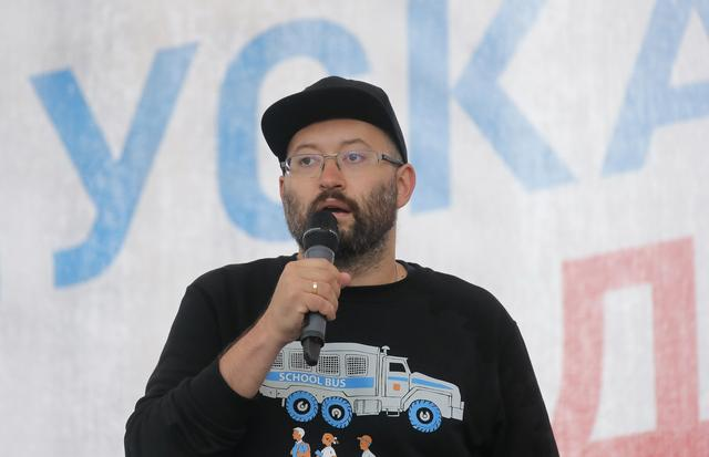 FILE PHOTO: Russian journalist Ilya Azar delivers a speech during a rally to demand authorities allow opposition candidates to run in the upcoming local election in Moscow, Russia August 10, 2019. REUTERS/Maxim Shemetov/File Photo