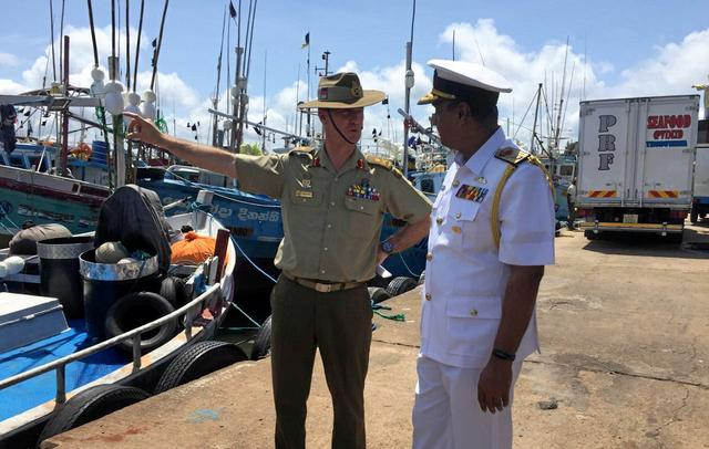 Head of Australia's operation to combat illegal maritime migration Major General Craig Furini inspects the western fisheries harbor next to Sri Lanka Navy Director-General operations Niraja Attygalle after a news conference about illegal migrations during his visit, in Negombo, Sri Lanka, September 3, 2019. REUTERS/Ranga Sirilal