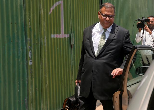 FILE PHOTO: Sri Lanka's former Central Bank Governor Arjuna Mahendran leaves the Presidential Commission of Inquiry to Investigate and Inquire into the Issuance of Treasury Bonds in Colombo, Sri Lanka March 10, 2017. REUTERS/Dinuka Liyanawatte
