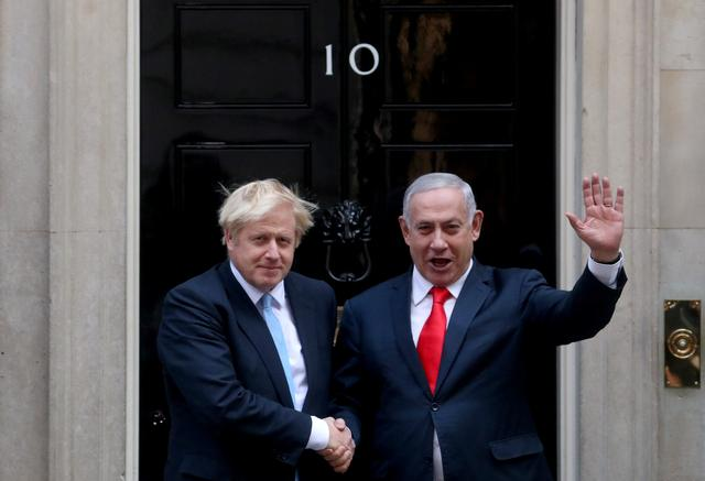 Britain's Prime Minister Boris Johnson welcomes Israel's Prime Minister Benjamin Netanyahu outside Downing Street in London, Britain September 5, 2019. REUTERS/Hannah McKay
