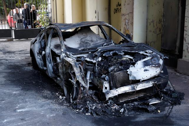 A view shows a burnt car, which is reportedly owned by former Governor of the Ukrainian Central Bank Valeria Gontareva's family members, in Kiev, Ukraine September 5, 2019. REUTERS/Valentyn Ogirenko