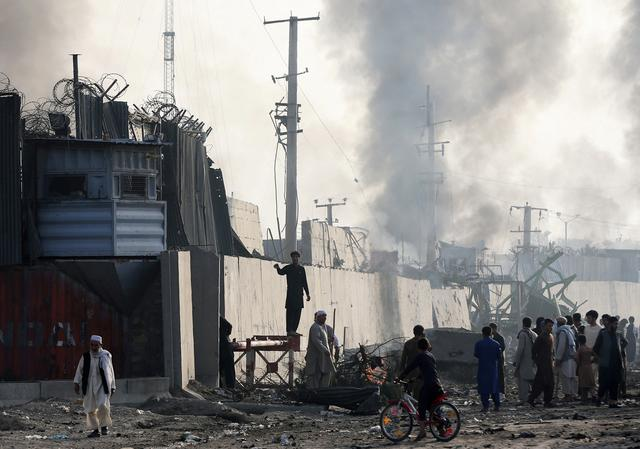 FILE PHOTO: Angry Afghan protesters burn tires and shout slogans at the site of a blast in Kabul, Afghanistan September 3, 2019. REUTERS/Omar Sobhani/File Photo