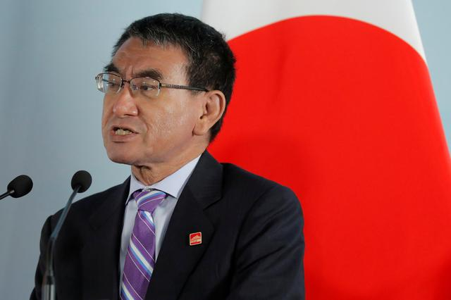 FILE PHOTO: Japanese Foreign Minister Taro Kono speaks beside South Korean Foreign Minister Kang Kyung-wha (not pictured) and Chinese Foreign Minister Wang Yi (not pictured) during a press conference after the ninth trilateral foreign ministers' meeting among China, South Korea and Japan at Gubei Town in Beijing, China, 21 August 2019. Wu Hong/Pool via REUTERS