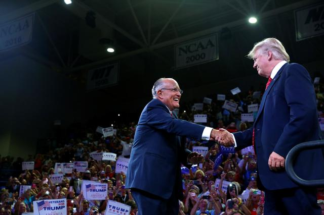 FILE PHOTO - Former New York mayor Rudy Giuliani greets Republican U.S. presidential nominee Donald Trump at the Trask Coliseum at University of North Carolina in Wilmington, North Carolina, U.S., August 9, 2016. REUTERS/Eric Thayer